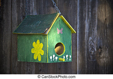 Bird house on the fence