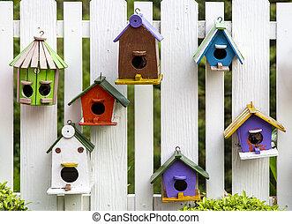 Bird house on wood fence