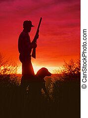 Bird Hunter and Dog in Sunrise - a bird hunter and his dog...