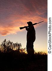 Bird Hunter at Sunrise - a bird hunter stands in wait...