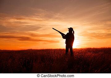 Bird Hunter at Sunset