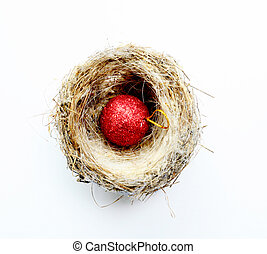 bird nest with christmas decoration red bauble