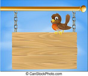 Bird on wood sign