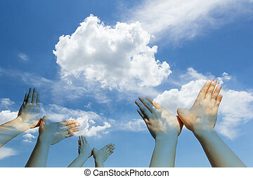 Bird shaped hands on cloud and sky