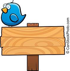 Bird Sign - A cartoon bird on top of a sign.