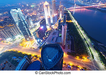 Bird view at Nanchang China. Skyscraper under construction in foreground. Fog, overcast sky and pollution. Bund (Nanchang) area