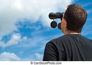 Bird Watcher - Low angle view of a bird watcher using...
