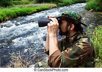 bird watching in nature - The naturalist in military uniform...