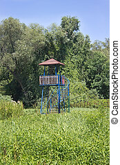 Bird watching tower in a forest