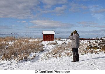 Birder by the coast in winter season