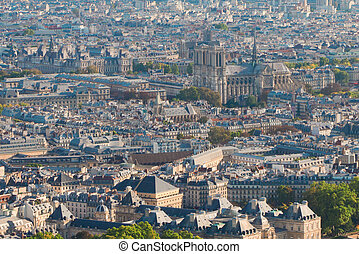 Birdeye view of Paris roofs with Notre Dame cathedral,...