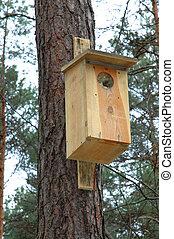 Birdfeeder - birdfeeder made of wood stack to a tree in...