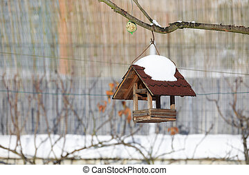 birdhouse in winter garden