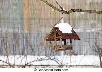 birdhouse in winter garden