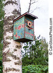 Birdhouse on a birch tree