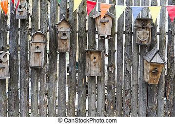 Birdhouses on the fence.