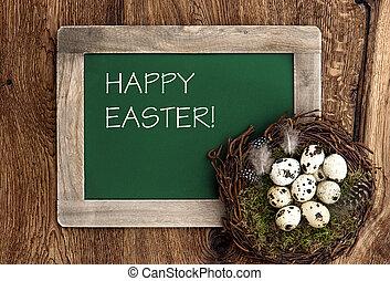 birds eggs in nest and vintage blackboard