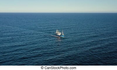 Aerial view of a fishing boat sailing in the Atlantic Ocean
