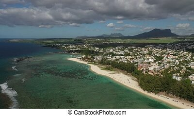 bird's eye view of a suburb with a beautiful white beach on the island of Mauritius.