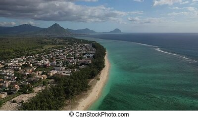 bird's eye view of a suburb with a beautiful white beach on the island of Mauritius