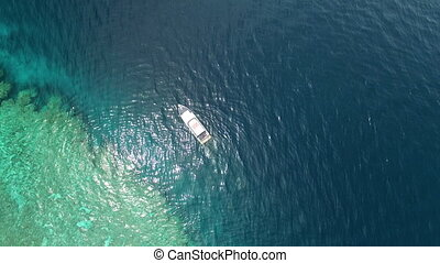 Birds eye view of a yacht on ocean