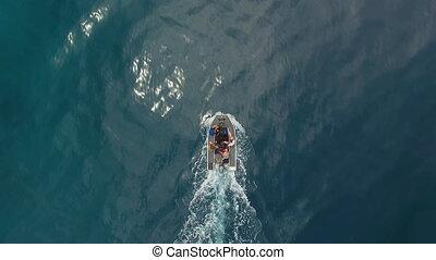 Birds eye view of boat on ocean - A birds eye view shot of a...