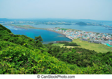 Bird's eye view of Jeju island from the summit of Sunrise Peak. Suitable for concepts such as success, environment, mountain climbing, and travel and vacation.