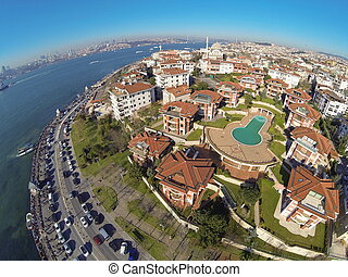 Birds eye view of luxury houses and a swimming pool at Uskudar, Istanbul. Looking down on a residential housing community.