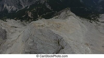 Bird's eye view of mountain ridge with view raising towards...