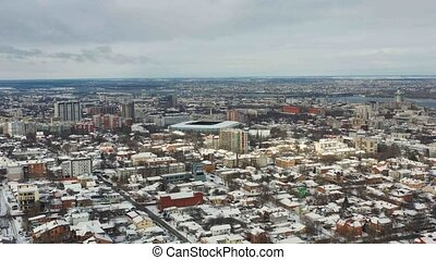 Bird's eye view of snow-covered Dnipro city downtown....