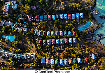 Bird's-eye view of the hotel complex. Grey part of the island of Mauritius