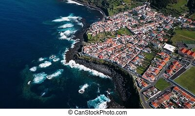Bird's eye view of the ocean surf on the reefs coast in Maia city of San Miguel island, Azores, Portugal.
