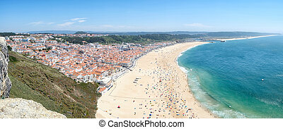 Bird's-eye view on Nazare beach riviera on the coast of Atlantic ocean. Nazare. Portugal