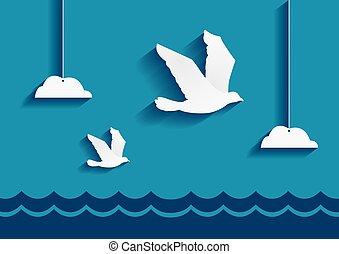 Birds flying over the ocean