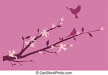 Blossoming branch of a cherry with a bird flying up to it