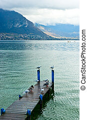 Lake Annecy - Birds on wooden pier at Lake Annecy,...