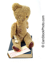 birth certificate and teddy bear