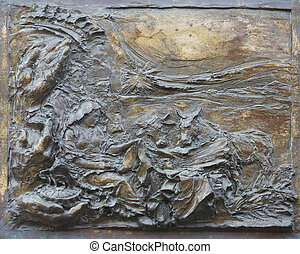 Birth of Jesus Christ, detail on the door of the church of St. James the Greater in Porto Azzurro, Elba, Italy