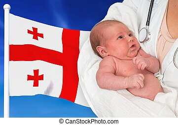Birth rate in Georgia. Newborn baby in hands of doctor.