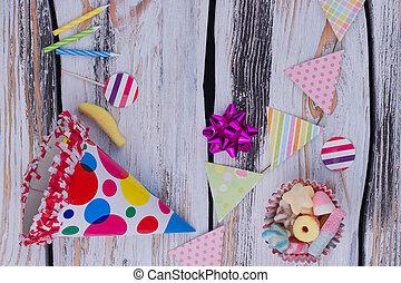 Birthday accessories on wooden background.