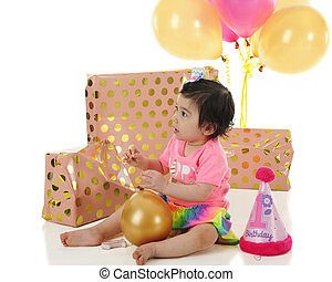 An Adorable One Year Old Sitting Among Her Wrapped Gifts And Ballons On Birthday A White Background