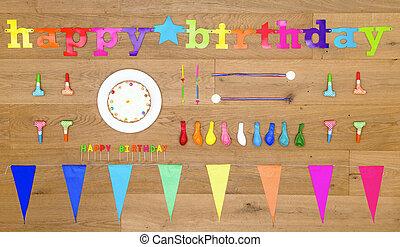 Birthday background items on wooden floor board