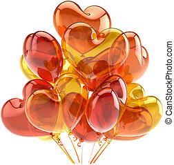Birthday balloons orange as hearts