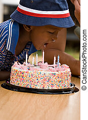Birthday boy - Happy African American boy with a cake on his...