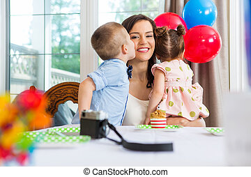 Birthday Boy Kissing Mother At Home