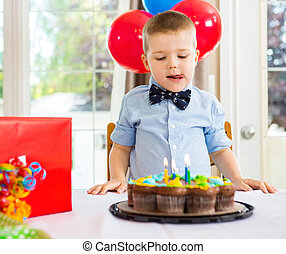 Birthday Boy Licking Lips While Looking At Cake