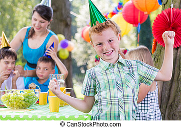 Birthday boy wearing party hat