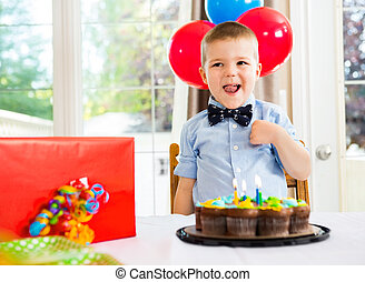 Birthday Boy With Cake And Present On Table - Happy boy with...