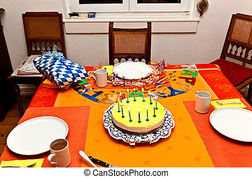 birthday cake at the table early morning with candles