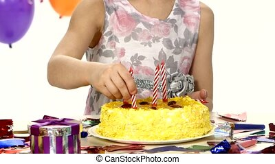 Birthday cake decorated with candles for the arrival of guests